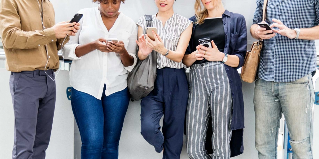 young adults using phones on social networks